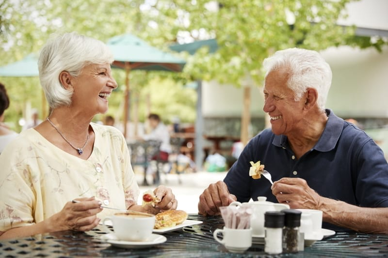 Senior Couple Enjoying Meal At Outdoor Cafe