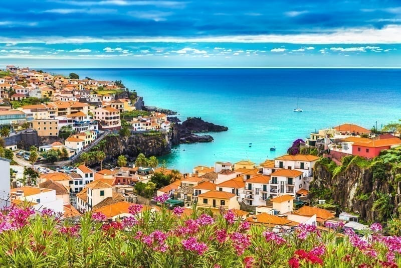 Stunning view in Madeira island, Portugal with bright sky and colorful flowers.