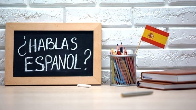 Do you speak Spanish written on board, international flag in box, language.