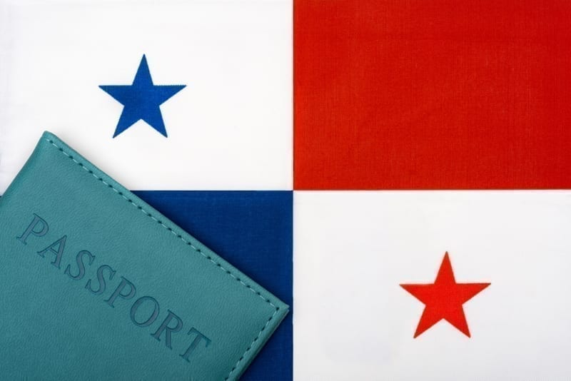 On the background of the flag of Panama is a passport.