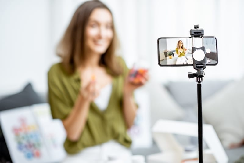 Woman recording her vlog