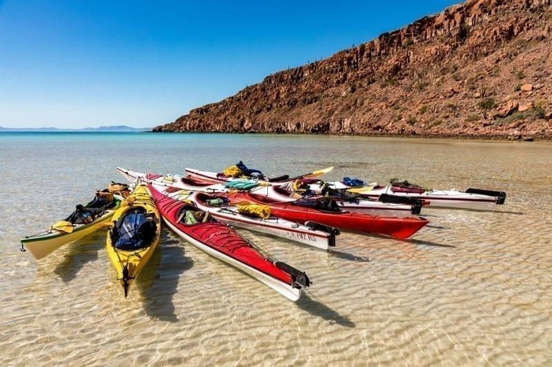 Kayaks float in a bay off Isla Espíritu Santo in the Gulf of California offshore of La Paz on the Baja California Peninsula, Mexico