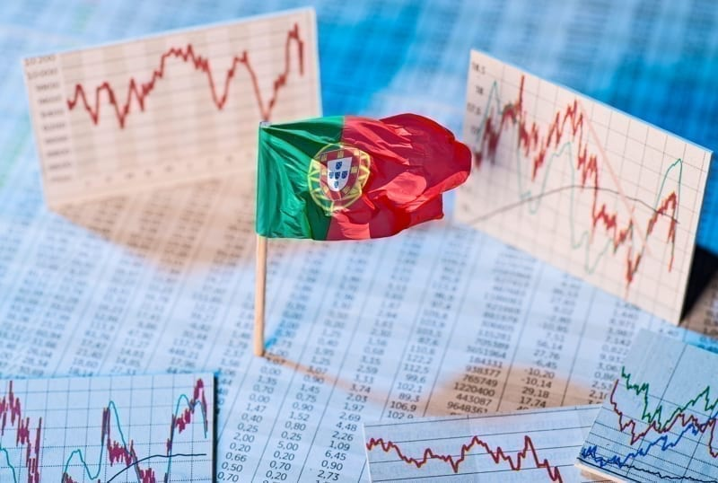 Portuguese flag with course tables and graphs on economic development