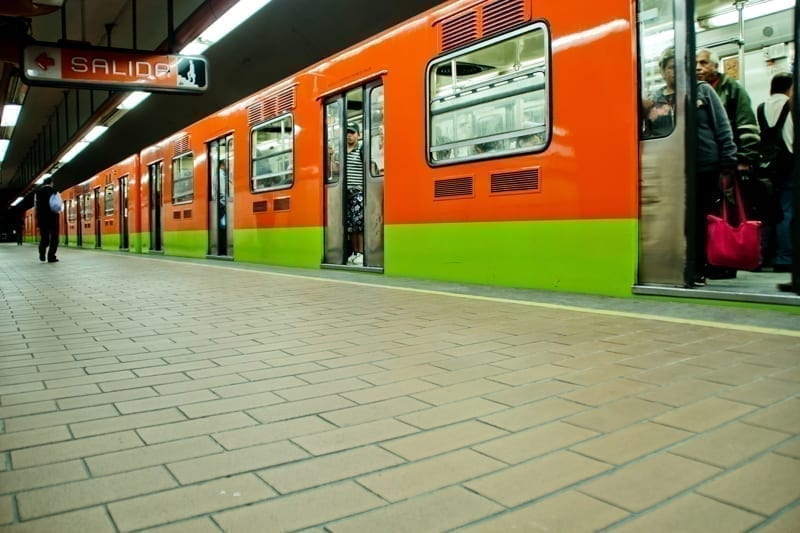Subway train and walk at station on a common day on Mexico City, Mexico.