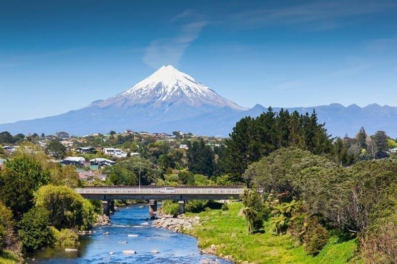 The Waiwhakaiho River, the city of New Plymouth, and Mount Taranaki, New Zealand