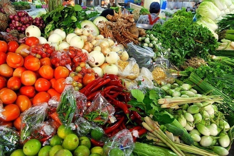 Fresh herbs, fresh spices and vegetables sold at a stall in Thanin Market, Chiang Mai, Thailand.