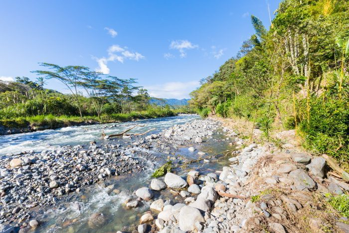 Caldera creek in the jungle with blue sky in a sunny day panoramic view in Panama