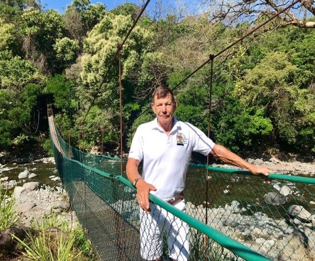 Frank Stegmeier standing on a brige over a river
