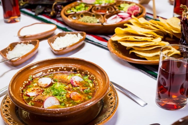 Trditional pozole mexican food table