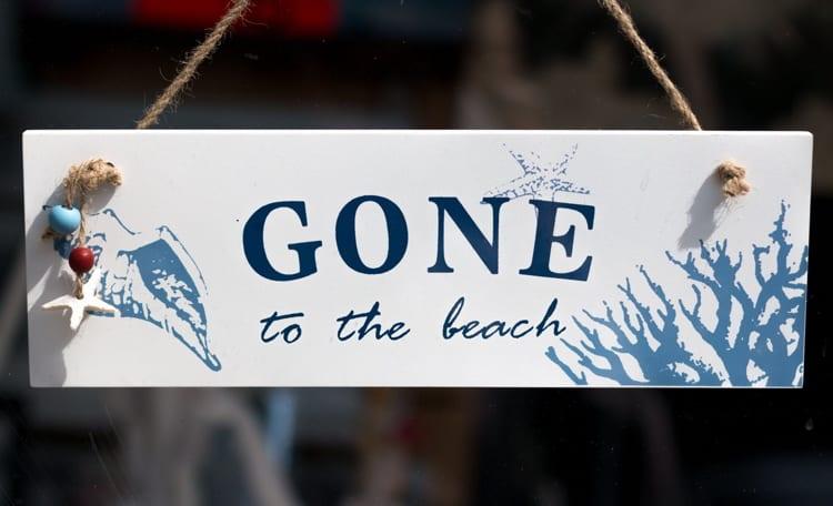 Gone to the beach sign hanging in shop door
