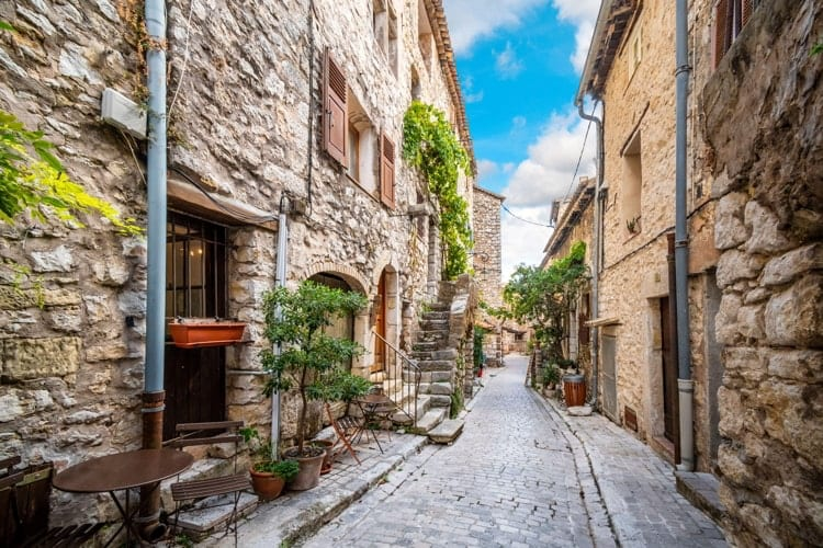 A picturesque back street of homes and apartments in the medieval village of Tourrettes Sur Loup in Southern France.