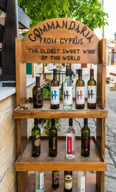 A stand selling local sweet wine in the traditional village of Omodos in Cyprus