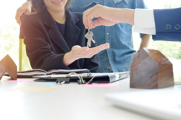 Lady receiving the keys to the home she will be renting