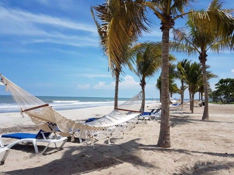 A white hammock in the white sand beach of Playa Caracol, Panama