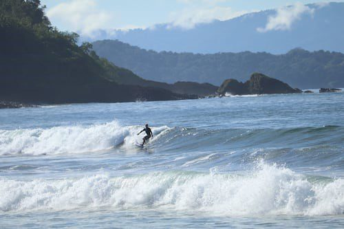 A person surfing in Playa Morrillo, Panama