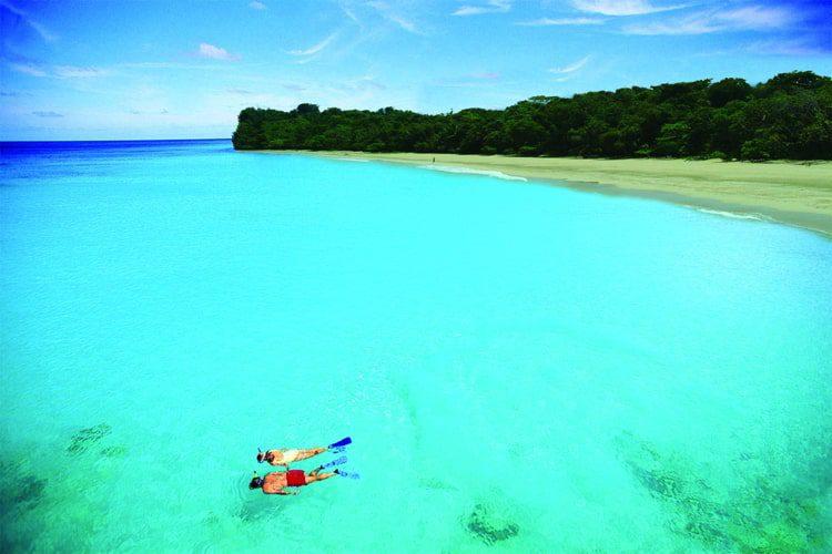 People snorkeling in Red Frog Beach in Panama