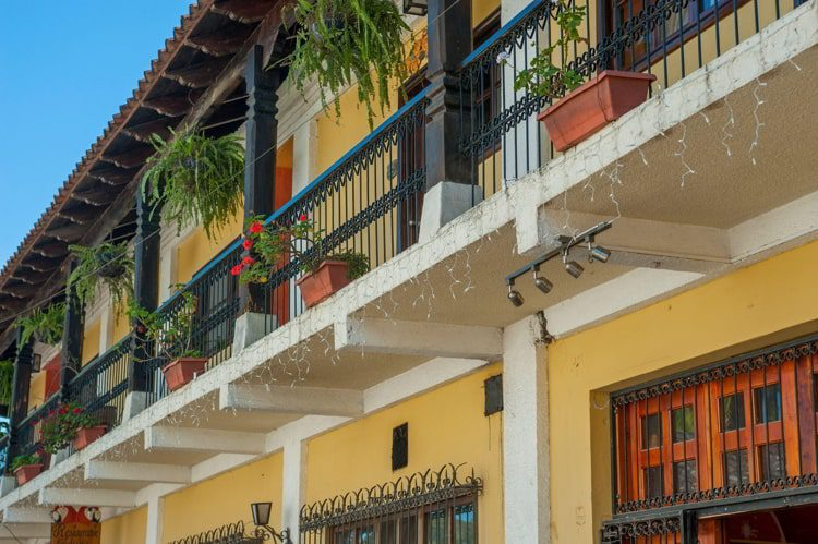 Detail of a colonial style house with a wrought iron balcony in the small city of Copan, Honduras