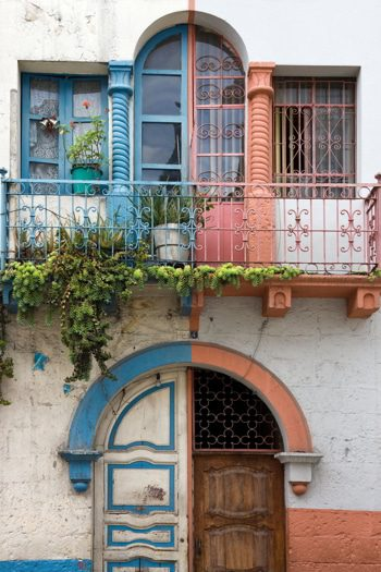 Old balcony on a house in Cuenca in Southern Ecuador