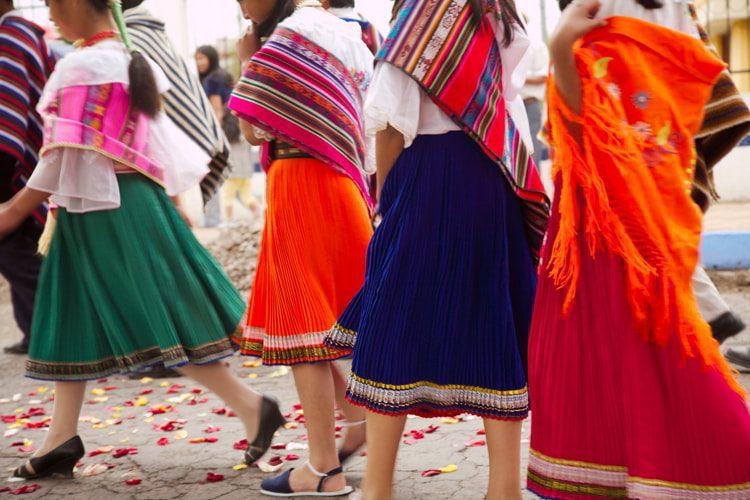 Colourful Highland dresses worn at a festival in Ambato, Cotopaxi Province, Ecuador