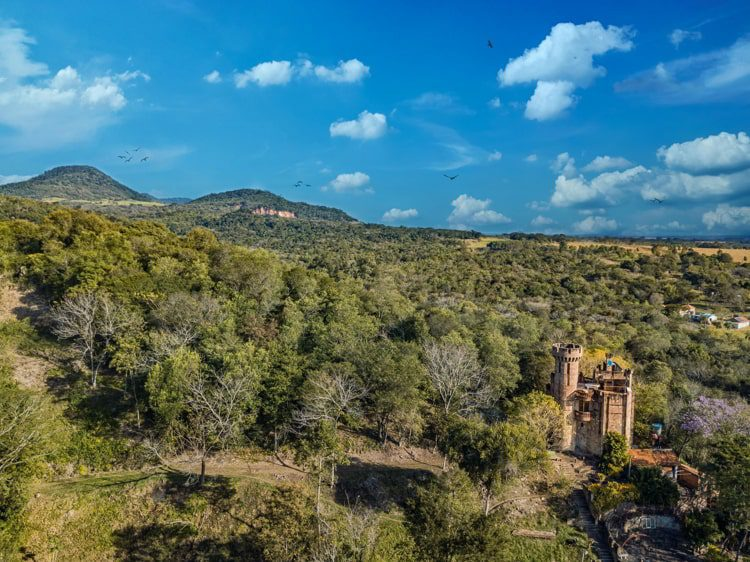 Aerial view of a castle in Paraguay overlooking the Ybytyruzu Mountains
