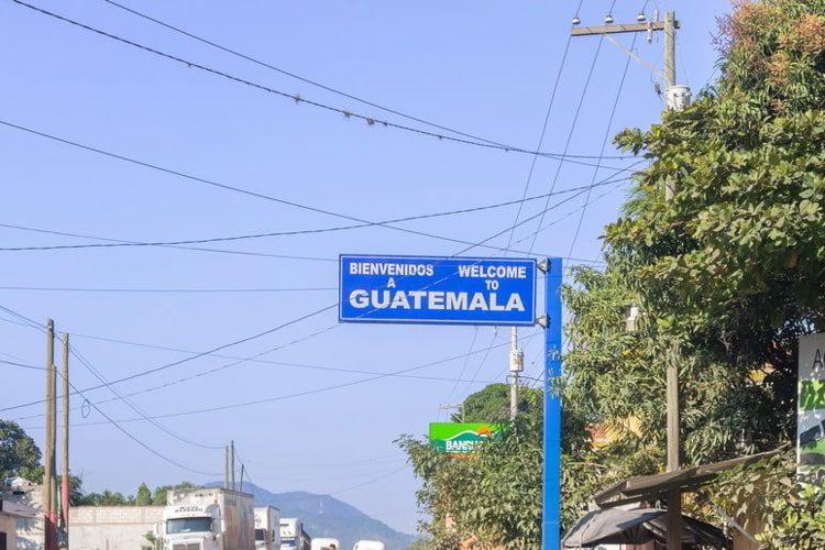 Welcome sign above road at Honduras, Guatemala border in El Florido