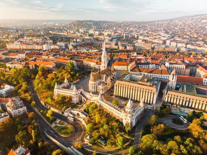 Aerial view of Fishermans Bastion and Matthias Church from above in Budapest during sunrise in autumn