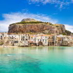 Medieval houses and La Rocca Hill, Cefalu, Sicily, Italy.