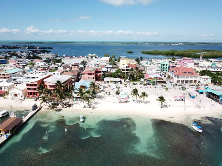 Areal image of houses and white sand beach in San Pedro Town, Belize