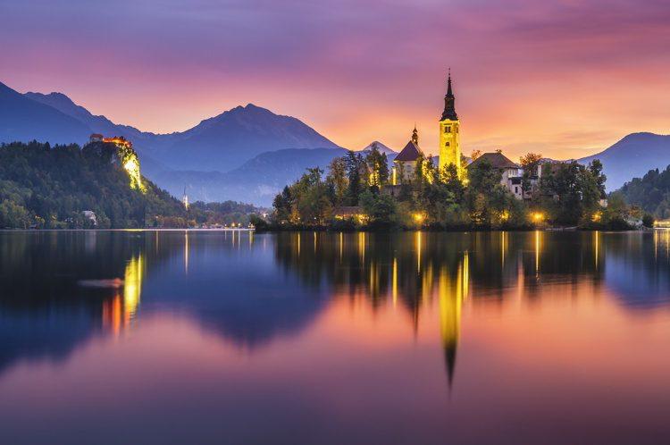 Multicolored sunrise over an alpine lake Bled in Slovenia