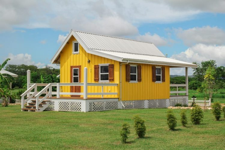 A bright yellow house in Carmelita Gardens in Belize